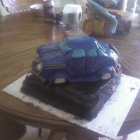 Car Cake   first time ever working with MMF. It was a lot of fun making this cake. My father in Law loved it. Thanks for looking. :)