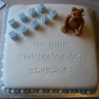 Christening Cake This was my 1st Cake. My sons christening cake, all fondant. the bear is shiney as he went in the fridge (before I learnt the lesson!) and...