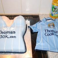 30Th Birthday Cake Not so rude as nothing on show but this is a cake for my brothers 30th as his passion is Manchester City football club, and his g/f boobs...