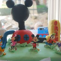 Mickey Mouse Club House Main Cake & Clubhouse dome all Victoria Sponge covered in fondant, Foot is RKT covered in Fondant, hand is all fondant (in hindsight...