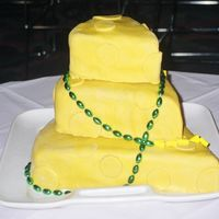 Packers Cheesehead Cake For A Rehearsal Dinner   White cake with buttercream filling and fondant icing. Go Packers!