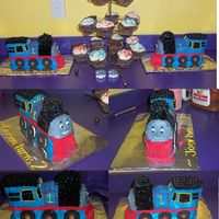 Two Thomas The Train Cakes  Double birthday party for my son and his friend. Used Wilton's 3-D Choo-Choo cake pan (worked great!) and decorated with buttercream...