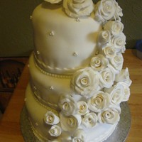 Wedding Cake  My first wedding cake. I still have a lot to learn when dealing with fondant, I just get frustrated when I cannot make it all smooth. I...