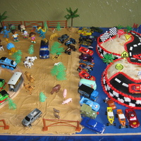 Race Track Cake I made this cake for my 3 year old son. He loves cars, but also loves Diego, Dora and Boots and Thomas and his friends. I decided to make a...
