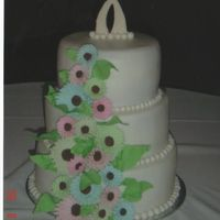 Gerber Daisy Wedding Cake 3 tier double -layered cakes,buttercream icing, rolled fondant balls around each layer, choc. transfer topper and gumpaste gerber daisies...