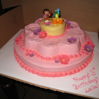 "Pink Flower Dora Cake My little niece requested a pink Dora cake from her auntie. The first thing she said when she saw it was ""where's Swiper""? I..."