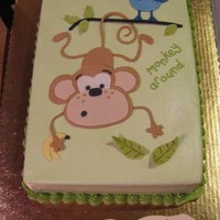 Monkey Around White sour cream pudding cake with bavarian cream filling, b/c frosting, fondant decorations. I matched it to a baby blanket for a jungle-...