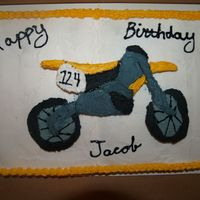 048.jpg This was a birthday cake I done for a client. I used a template to carve the dirt bike out of cake and then iced it.