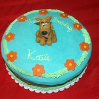 Scooby Doo Birthday Cake This was done for a little girl that loves Scooby. Scooby is made out of gumpaste as well as the flowers. The rest of the cake is...