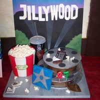 "Jillywood movie themed cake, triple choc with choc fudge frosting, movie reels of cake, real popcor, fondant bucket, hand painted ""cherry coke..."