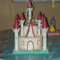 Skylars Castle castle cake, vanilla and chocolate, fondant flowers and acents