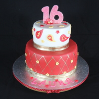 Sweet Sixteen Birthday Cake 2-tier Eastern Indian inspired cake in a red/gold color theme.