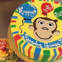 Curious?   First Birthday Cake to match curious george Party supplies, fiinished with rolled fondant accents.