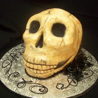Halloween Groom's Cake  Slightly larger than life size skull made of Devil's food cake and Italian Butter Cream. Covered with Fondant, stained with diluted...