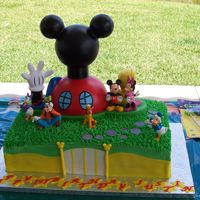 Justin's Mickey Mouse Clubhouse! This was for my friend's son's first birthday! He loves Mickey Mouse Clubhouse. It is a half choc. and half vanilla cake with...