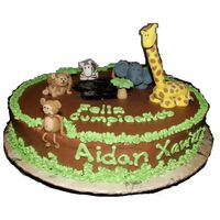 Jungle Cake This was my son's 1st B-day cake. Cream bouquet flavored yellow cake with Nutella buttecream frosting. All figurines are made of...