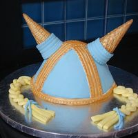 Viking Helmet Made with the wondermold pan. Fondant with ice cream cones for horns. I tried making the horns from Rice Krispie treats, but I couldn'...