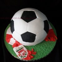 Football / Soccer Shaped Birthday Cake A cake for a very young liverpool fan! Hand painted liverpool logo