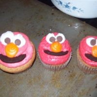 Elmo Cupcakes Yellow cake with oreo's without the filling for a smile, and milk chocolate chips as eyes. TFL