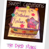 Stars   8in Square Cookies & Cream cake. Fondant stars bold colors and tye dye