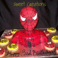 Spiderman   Loved making this cake. Covered in fondant and airbrushed to get the red color. Piped on the web design and added super hero cookies