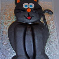 Kitty Cat Cake this is a vanilla cake with raspberry butercreamm covered in fondant and airbrushed black. The details are all done in fondant aswell