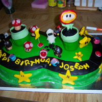 "Mario Kart Birthday Cake This a 2 10"" rounds put together into ""8"" race track. It is covered in MMFand all characters are made of MMF. Tubes are made..."