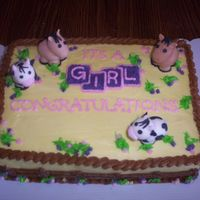 Western Baby Shower Cake Western/cowgirl baby shower cake. Fence design on sides, fondant molded cows and horses, colors of baby shower were yellow, purple and pink...