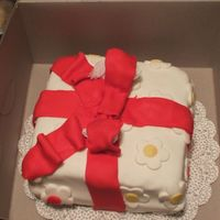 Red Present Cake This is a cake that I made to donate to the local elementary school. They were having their fall festival and it was for the cake walk. My...