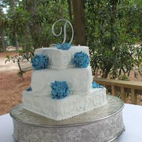 Blue Hydrangea Wedding Cake Buttercream yellow cake with buttercream filling. Bride wanted simple cake no special fillings just plain cake.