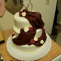 First Wedding Cake- Burgundy And White This is the first wedding cake that I have made, and I was definitely nervous about how it would turn out. Living in a remote community,...