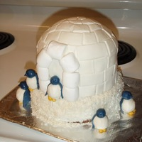 Igloo And Penguin Cake This idea was taken from a Martha Stewart Magazine, and was the perfect theme for our company Christmas party here in the Arctic. This cake...