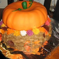 "Thanksgiving Pumpkin In A Basket Cake Made a bundt cake which was then placed on top of a 8"" round cake. The pumpkin is covered with MMF, and the basket is done with..."