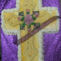 Femal First Communion Cake Purple base with Cross shaped cake and icing roses, with silk ribbon