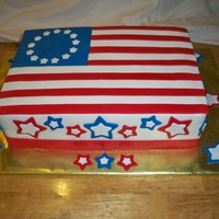 American Flag   Yellow and chocolate 9x13 cake. Fondant decorations
