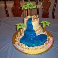 Tropical 16Th Birthday Fondant and gumpaste decorations. Gell waterfall. buttercream icing. Everything is edible!