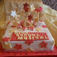 High School Musical Vanilla sponge covered with fondant with fondant stars on florist wire