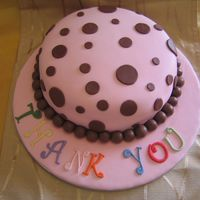 Pink/chocolate Polka Dot Thanks you cake for my daughter's nursery teacher. cake is chocolate malteser cake.
