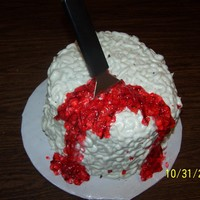 Bloody Brain Red velvet with cream cheese brain matter. I tried to carve it somewhat, but I didn't want to go too skinny on the bottom like the...