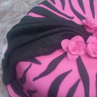 Hot Pink Zebra Stripes  Birthday cake for a great friend who loves animal print. She liked it a lot. It was far from perfect, especially near the bottom. How do...