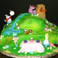 "Alice In Wonderland 1/4 sheet with 6"" carved round on top. Almond dream cake with chocolate mousse filling iced in buttercream. The lady supplied the..."