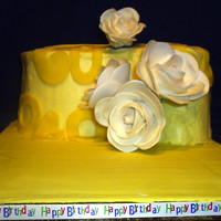 Lemon 60Th Birthday Cake A paisely shaped lemon cake was filled with lemon curd and frosted with lemon-colored buttercream. Fondarific fondant lemon was used to cut...