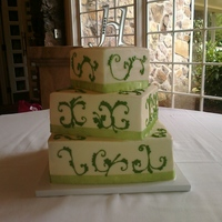 Spring Green Wedding Buttercream with royal icing (freehand) piped scroll work.