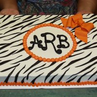 Zebra Monogram Fondant stripes and bow. Buttercream trim. Royal Icing monogram.