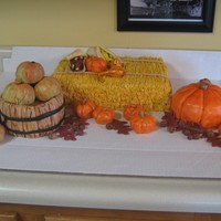 Fall This is a cake I did for a fall picnic.This was so fun to do. Everything is cake except the indian corn( RKT covered w/fondant.