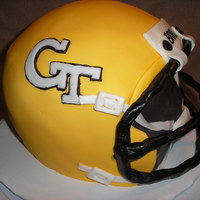Ga Tech Helmet A Georgia Tech football helmet cake for a boy turning 13. (I was hoping he would choose his OTHER favorite team, Alabama, for loyalty'...