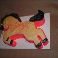 Pony Cake Large pony-shaped cake for a girl's birthday. All buttercream. Cut from a template made from an enlarged coloring book page. It was A...