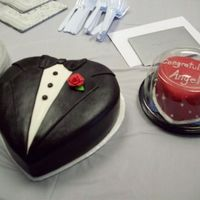 Tuxedo Cake & Heart Along with bride's bodice cake, made for company congratulations party. Covered in fondant. Sugar pearls on side of heart.