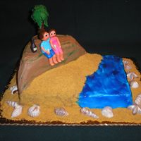 Maui Engagement Cake for engagement party. Proposal happened on mountain in Maui at sunset with a bottle of champagne. Buttercream with fondant figures,...