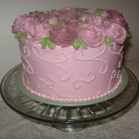 Pink Rose Cake Got the idea from a Wilton decorating book. I am new to decorating and this is my first time using all BC. I had a tough time getting the...